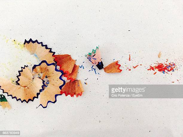 Close-Up Of Pencil Shavings On White Table