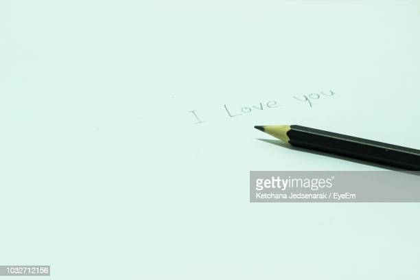 close-up of pencil with i love you text on white paper - i love you photos et images de collection