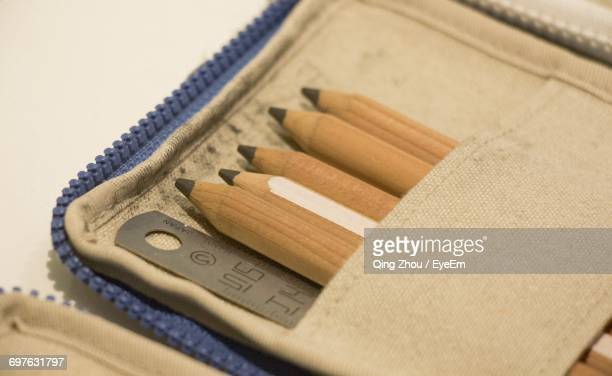 Close-Up Of Pencils And Ruler In Pouch On Table