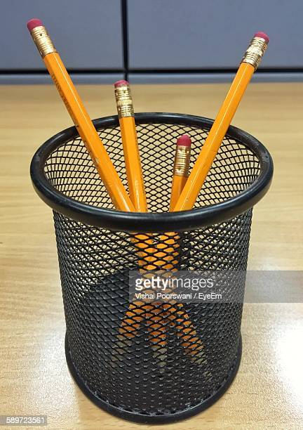 Close-Up Of Pencils In Desk Organizer On Table At Office