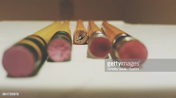 Close-Up Of Pencils With Erasers On Desk