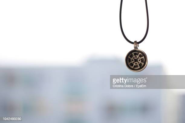 close-up of pendant and chain - pendant stock pictures, royalty-free photos & images