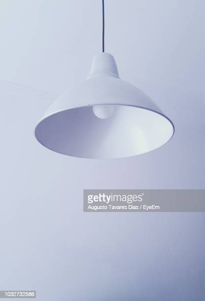 Close-Up Of Pendant Light Hanging Over White Background