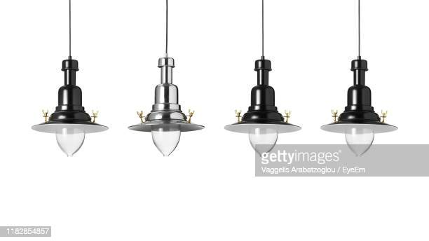 close-up of pendant lights against white background - pendant light stock pictures, royalty-free photos & images