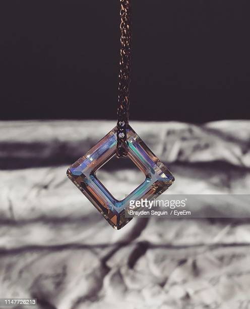 close-up of pendant - pendant stock pictures, royalty-free photos & images