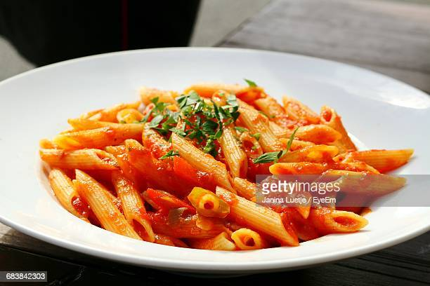 close-up of penne arabiata in bowl - marinara stock photos and pictures