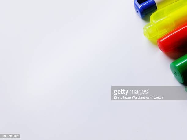 Close-Up Of Pens Over White Background