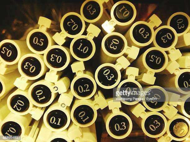 Close-Up Of Pens With Numbers