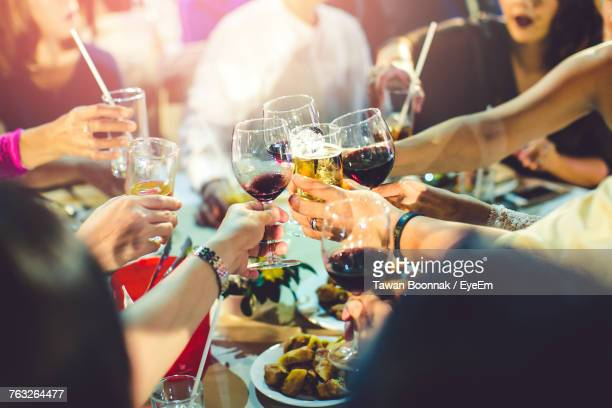 close-up of people drinking glasses on table - wine stock pictures, royalty-free photos & images