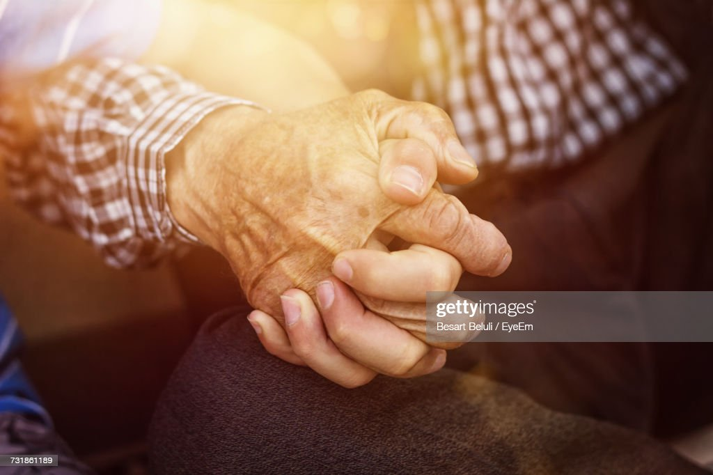 Close-Up Of People Holding Hands : Stock Photo