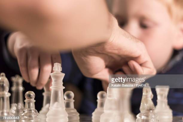 close-up of people playing chess - reality kings stock pictures, royalty-free photos & images