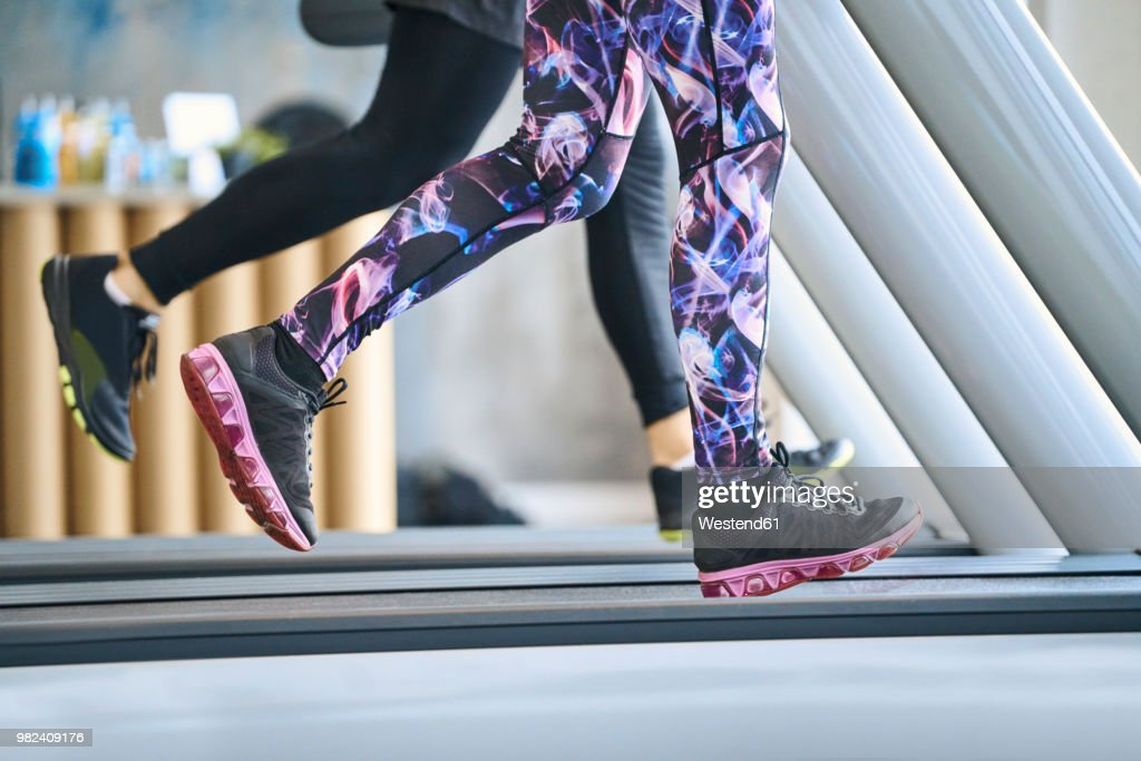 Close-up of people running on treadmill at gym : Stock Photo