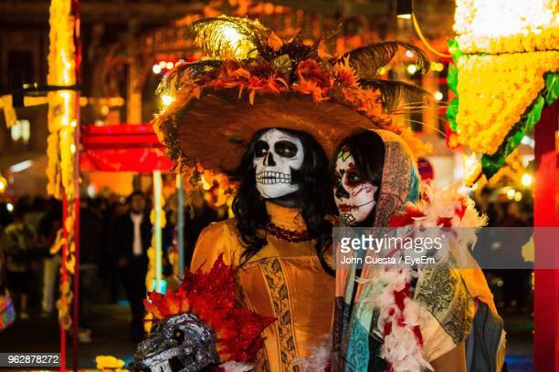 close-up of people with spooky make-up at night during carnival - mexico city stock pictures, royalty-free photos & images