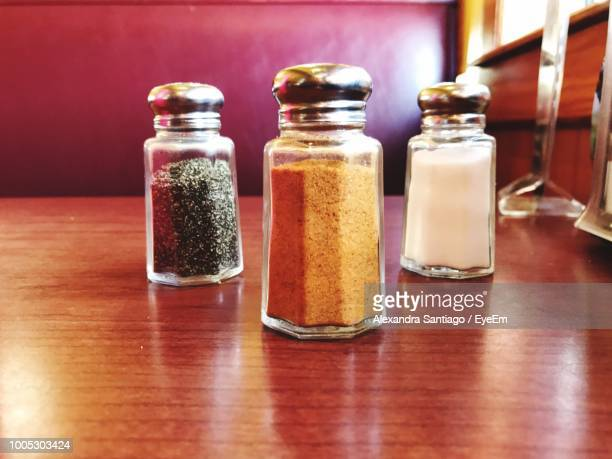 close-up of pepper shaker on table - pepper seasoning stock photos and pictures