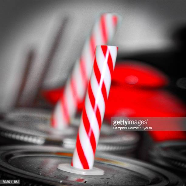 close-up of peppermint straws in drinks cans - campbell downie stock pictures, royalty-free photos & images