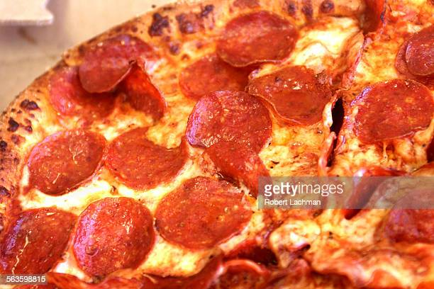 A closeup of pepperoni pizza from Domino's Pizza in Huntington Beach