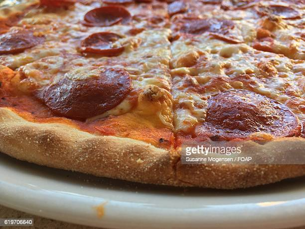 Close-up of pepperoni pizza on plate