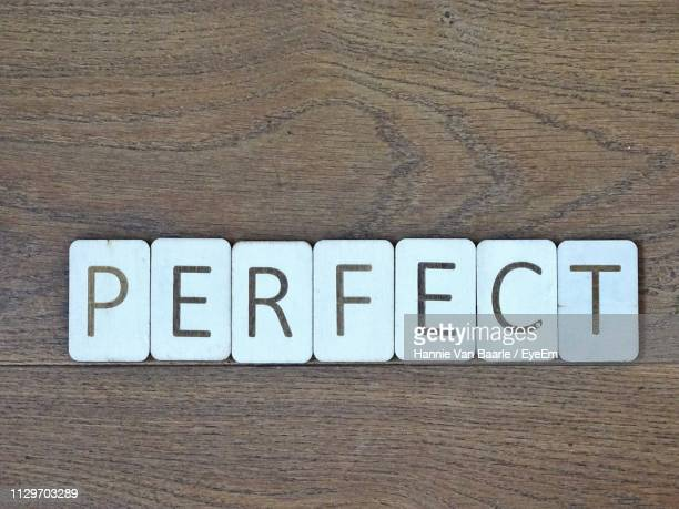 Close-Up Of Perfect Text On Table