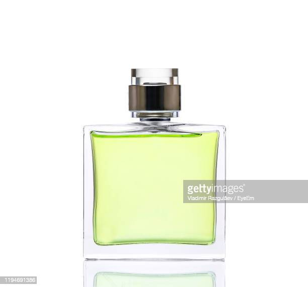 close-up of perfume bottle against white background - perfume stock pictures, royalty-free photos & images