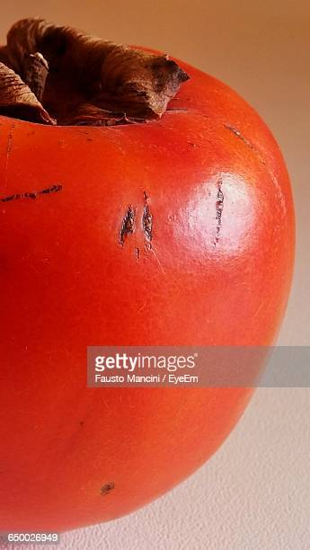 Close-Up Of Persimmon On Table