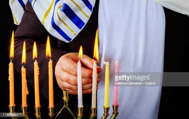close-up of person burning candles - judaism stock pictures, royalty-free photos & images