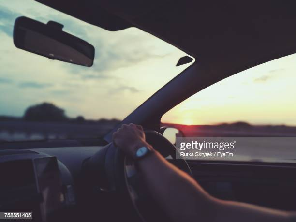 close-up of person driving car - vehicle mirror stock photos and pictures