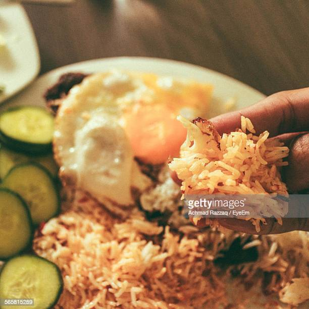 Close-Up Of Person Eating Biryani