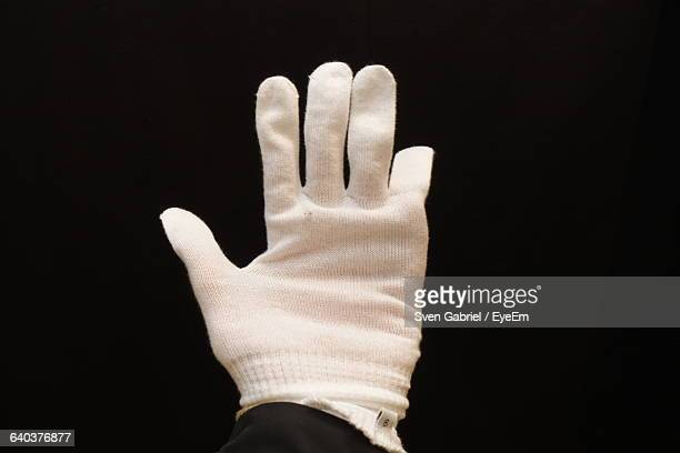 Close-Up Of Person Hand Wearing Glove