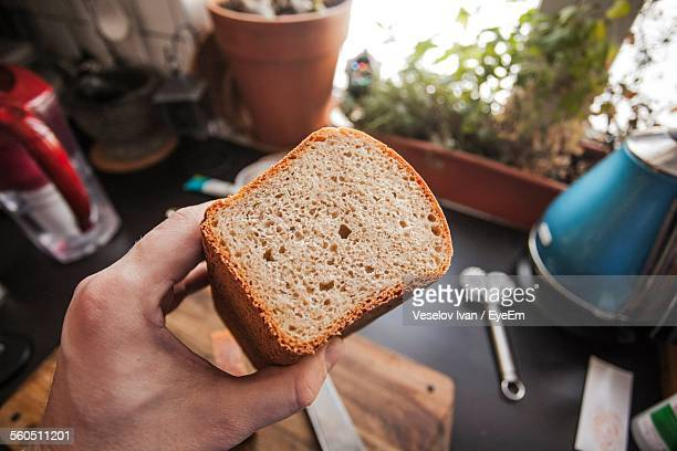close-up of person holding bread - whole wheat stock pictures, royalty-free photos & images