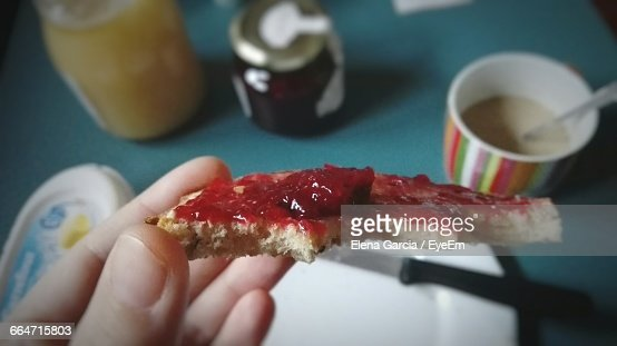 Close-Up Of Person Holding Jam Bread