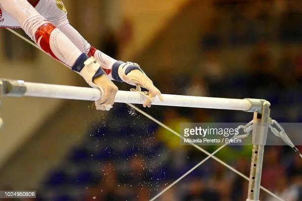 close-up of person on metal pipe - gymnastique sportive photos et images de collection