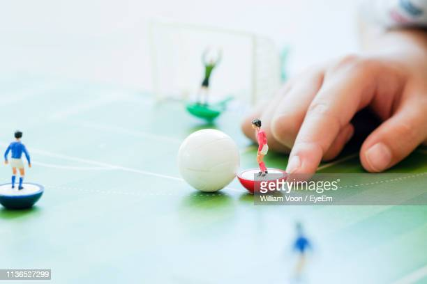 close-up of person playing figurine soccer - human representation stock pictures, royalty-free photos & images