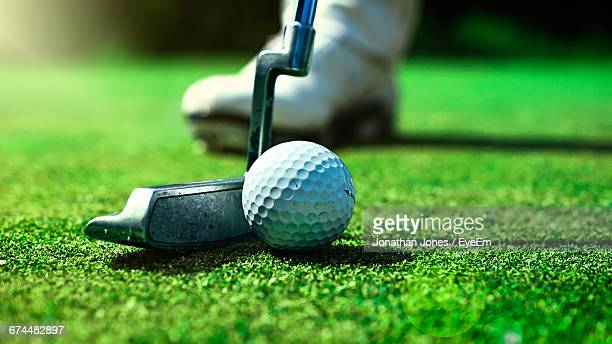 Close-Up Of Person Playing Golf