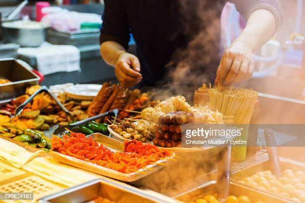 close-up of person preparing food - kowloon peninsula stock pictures, royalty-free photos & images