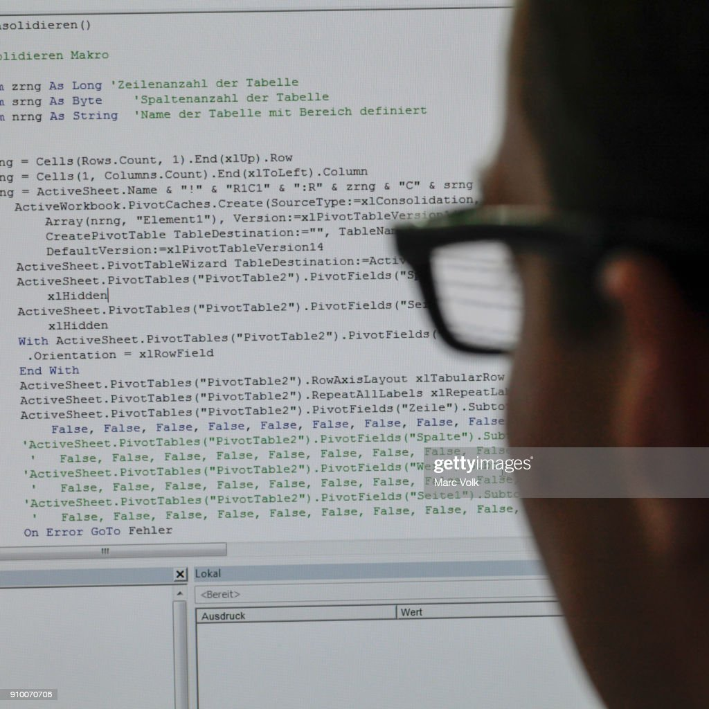 Close-up of person reading programming code on computer screen : Stock-Foto