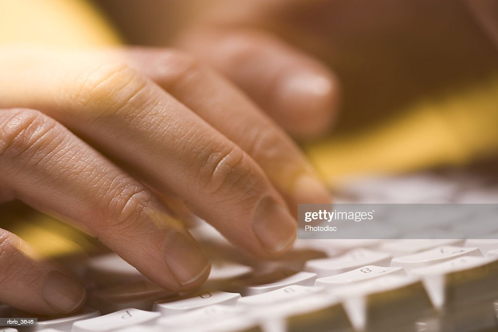 Close-up of person typing on a computer keyboard : Foto de stock