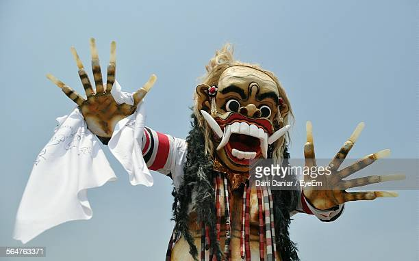 close-up of person wearing devil costume against sky - devil costume stockfoto's en -beelden