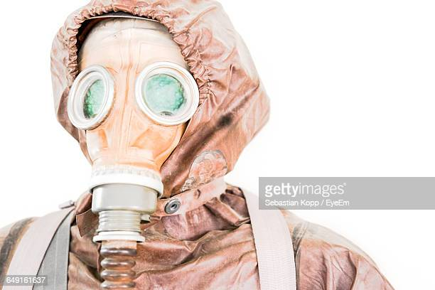 close-up of person wearing gas mask on white background - hazmat stock pictures, royalty-free photos & images