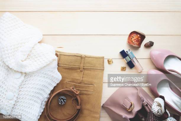 close-up of personal accessories on table - womenswear stock pictures, royalty-free photos & images