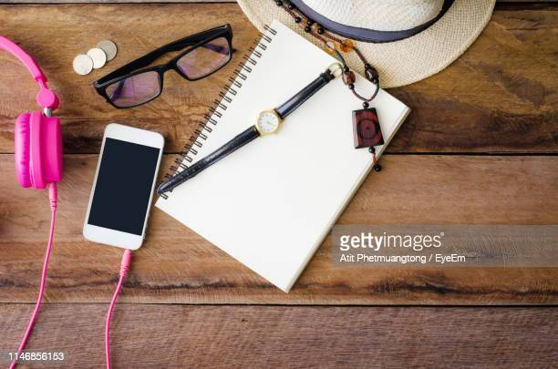 close-up of personal accessories on table - personal accessory stock pictures, royalty-free photos & images