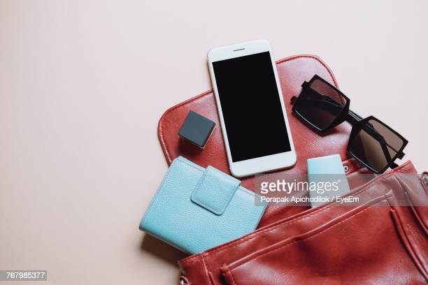 close-up of personal accessories over white background - clutch bag stock pictures, royalty-free photos & images
