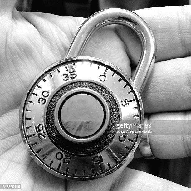 Close-Up Of Persons Hand Holding Lock