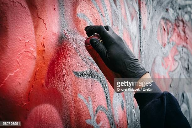 close-up of persons hand tagging wall with graffiti - spray paint stock pictures, royalty-free photos & images