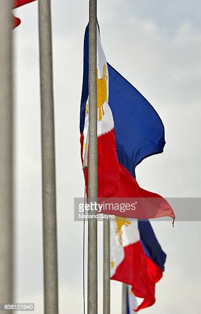 close-up of philippine flags against clear sky - philippines flag stock pictures, royalty-free photos & images