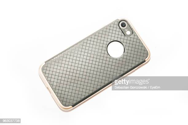 close-up of phone cover over white background - phone cover stock pictures, royalty-free photos & images