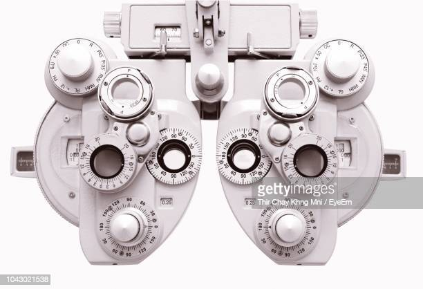 close-up of phoropter against white background - eye test equipment stock pictures, royalty-free photos & images