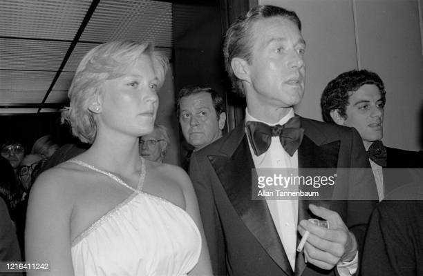 Close-up of photojournalist Susan Ford and Halston as they arrive at the Four Seasons , New York, New York, May 17, 1977.