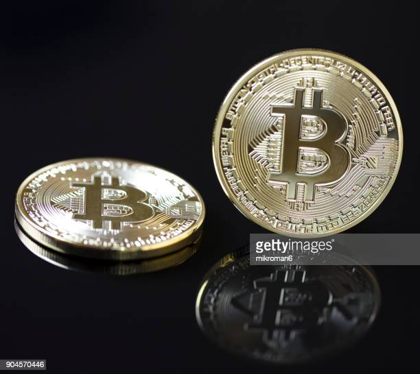 Close-Up Of Physical version of Bitcoin coin. Golden bitcoin coin on black background
