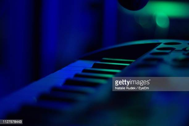 close-up of piano keys in dark - keyboard instrument stock photos and pictures