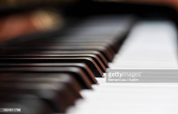 close-up of piano keys - grand piano stock pictures, royalty-free photos & images